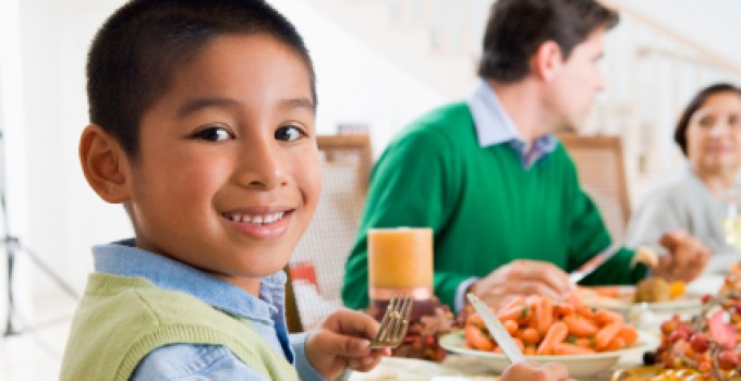 boy eating family meal cropped