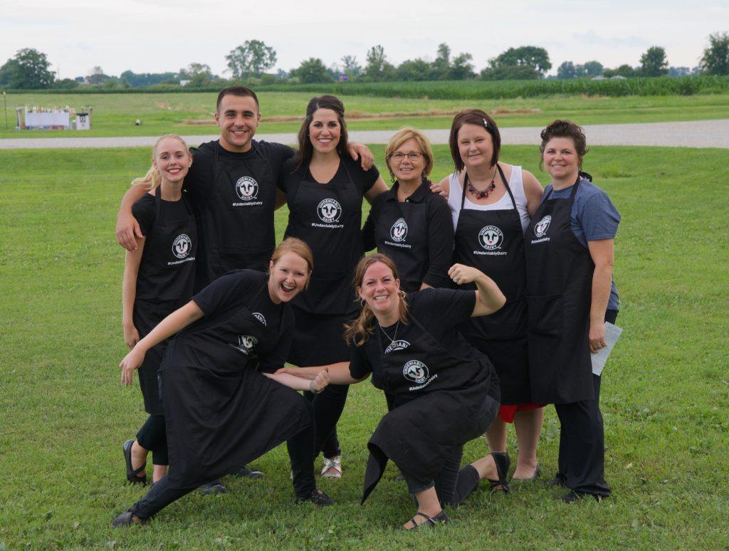 Group photo of people in aprons after Dinner on the Farm